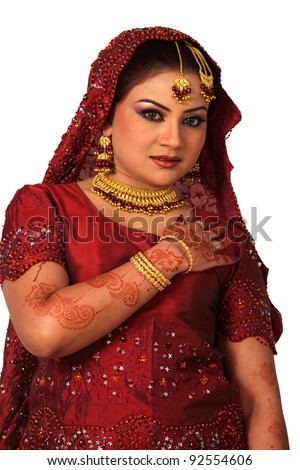 Beauty portrait of a young indian woman in traditional clothes with bridal makeup and jewelry, closeup shot - stock photo