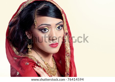 Beauty portrait of a young indian woman in traditional clothing, closeup shot - stock photo
