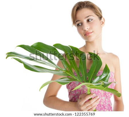 Beauty portrait of a young woman holding a perfectly shaped tropical green leaf, isolated on a white background.