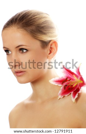 beauty portrait of a young woman isolated on white background with a flower