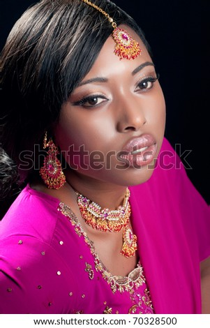 Beauty portrait of a young woman wearing indian clothes and jewelry, closeup shot - stock photo