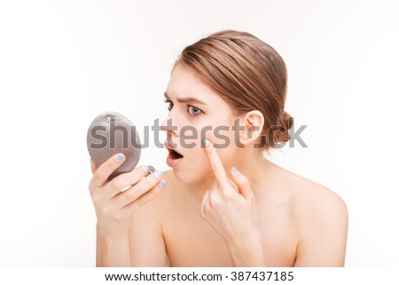 Beauty portrait of a young woman with mirror isolated on a white background
