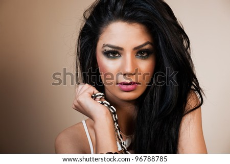 beauty portrait of an attractive Indian female fashion model - stock photo