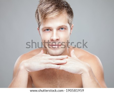 Beauty portrait of an young handsome man - stock photo