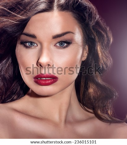 Beauty portrait of attractive brunette woman with perfect makeup. Girl looking at camera. Closeup photo. - stock photo
