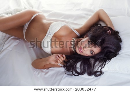 Beauty portrait of attractive sexy brunette woman with long hair looking at camera. - stock photo