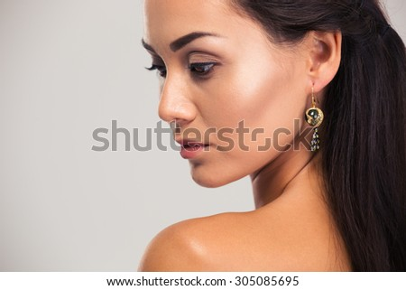 Beauty portrait of attractive woman looking away isolated on a white background - stock photo