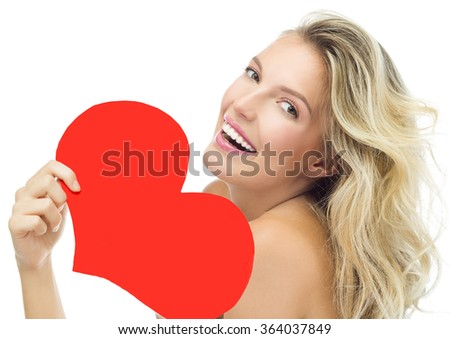 beauty portrait of attractive young caucasian smiling woman blond isolated on white studio shot lips toothy smile face long hair head and shoulders looking at camera red heart valentine's love - stock photo