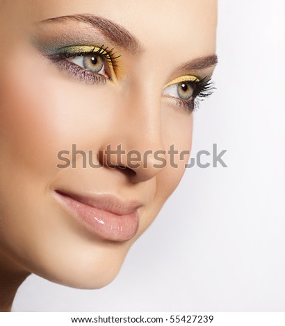 Beauty portrait of attractive young caucasian  smiling woman. close up face, makeup, eyes, lips, skin, isolated on white background, studio shot - stock photo