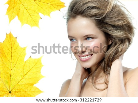 beauty portrait of attractive young caucasian woman blond isolated on white studio shot face long hair head and shoulders autumn yellow maple leaf smiling happy