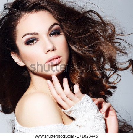 Beauty portrait of beautiful brunette girl in the studio - stock photo