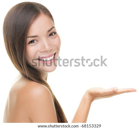 Beauty portrait of beautiful woman showing beauty product / empty copy space on open hand palm. Mixed race Asian / Caucasian female model isolated on white background. - stock photo