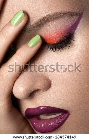 Beauty portrait of beautiful woman with summer colors make-up and manicure. Perfect clean and smooth skin, green mint nail polish, bright eyes and lips makeup