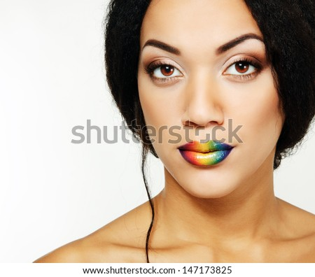 Beauty portrait of beautiful young mulatto fresh woman with rainbow lipstick, detail of face and shoulders closeup - stock photo