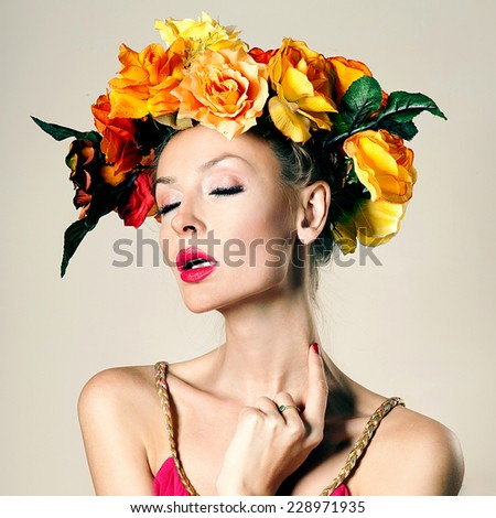Beauty portrait of blonde elegant woman with autumn flowers in head. Conceptual photo.
