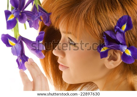 beauty portrait of cute redhead girl looking purple flowers