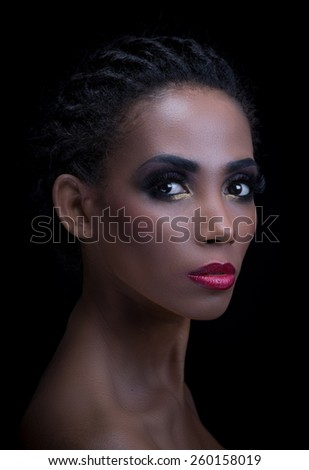 Beauty portrait of dark skin or mulatto woman on black - stock photo
