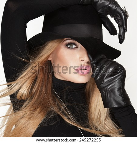 Beauty portrait of elegant blonde woman in hat. - stock photo