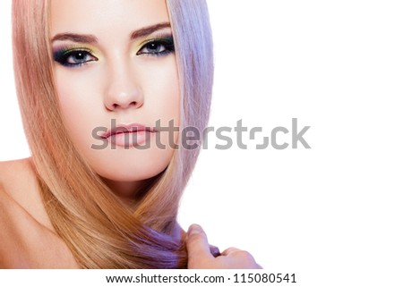 Beauty portrait of female model with colorful makeup on white background - stock photo