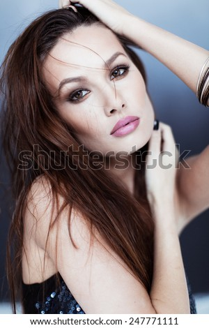 Beauty portrait of girl in top with sequins