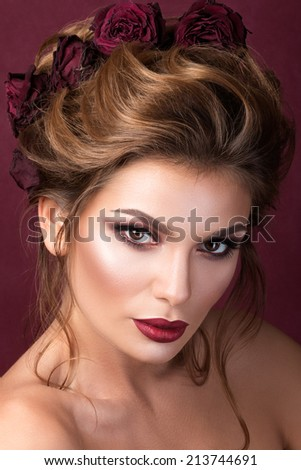 Beauty portrait of gorgeous adult woman with roses in her hair - stock photo