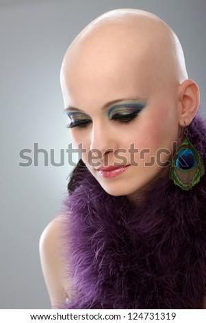 Beauty portrait of hairless woman in purple boa. - stock photo