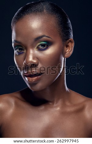 Beauty portrait of handsome ethnic african girl, on dark background - stock photo