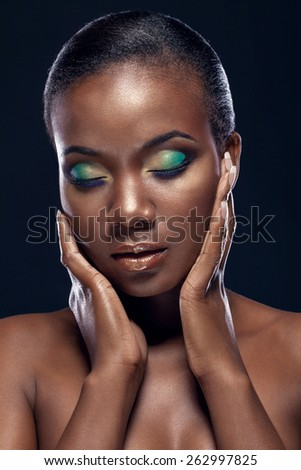 Beauty portrait of handsome ethnic african girl with closed eyes, on dark background - stock photo