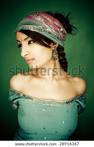 beauty portrait of indian girl with traditional cloths - stock photo