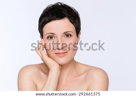 Beauty portrait of mature woman with fresh skin, concept of spa and skin care - stock photo
