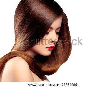 Beauty portrait of pretty model with long straight healthy hair isolated over white background. Young attractive Caucasian brunette girl  with professional make-up and hairstyle.  - stock photo