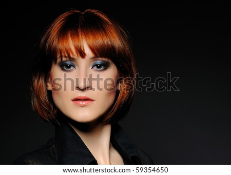 Beauty portrait of pretty woman with short fashion bob hairstyle and dark make-up. black background - stock photo