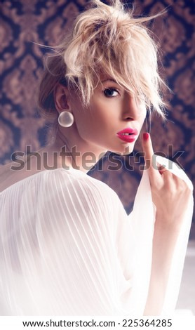 Beauty portrait of romantic blonde woman. Calm scene. Indoor photo.