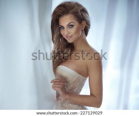 Beauty portrait of romantic blonde woman. Calm scene. Indoor photo. - stock photo