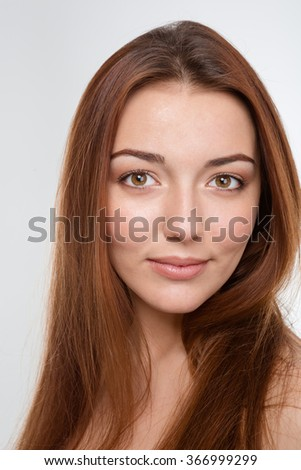 Beauty portrait of sensual attractive young woman with long brown hair over white background - stock photo