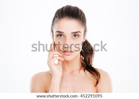 Beauty portrait of sensual young woman touching skin on her face over white background - stock photo