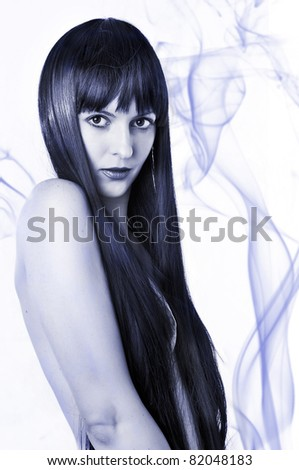 beauty portrait of sexual nude woman with long black hair and smoke - stock photo