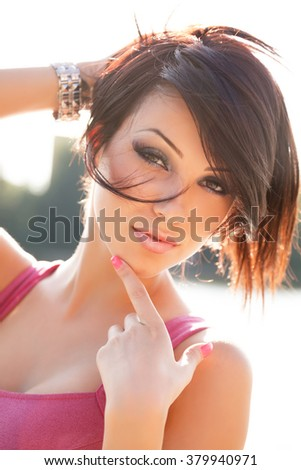 Beauty portrait of sexy young woman outdoors - stock photo
