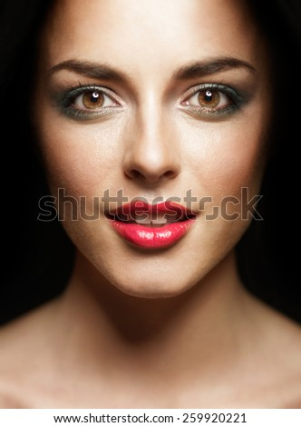 beauty portrait of sexy young woman wearing makeup and smiling - stock photo