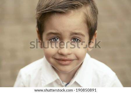 Beauty portrait of small happy boy - stock photo
