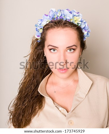 beauty portrait of woman with flowers wreath in hair - stock photo