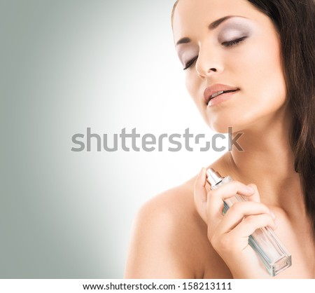 Beauty portrait of young, attractive, fresh, healthy and natural woman with the perfume bottle  - stock photo
