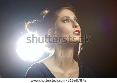 Beauty portrait  of young brunette woman with studio lights - stock photo