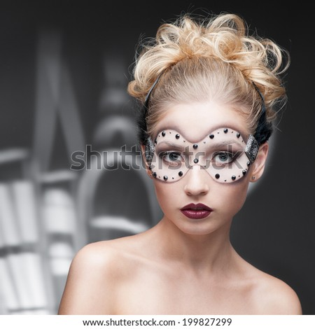 beauty portrait of young caucasian blond woman in fantasy make-up over cartoon style houses on background - stock photo
