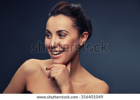 Beauty portrait of young caucasian brunette woman. Smiling and perfect skin. Natural nude makeup. Toned - stock photo