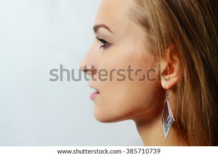 Beauty portrait of young girl in profile with blond hair, studio shot - stock photo