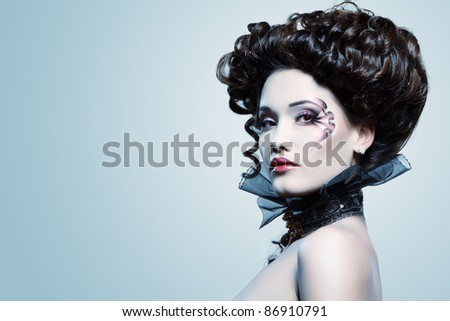 beauty portrait of young glamour beautiful halloween woman vampire baroque aristocrat over blue background - stock photo