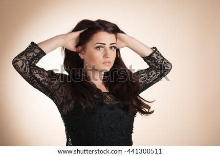 Beauty portrait of young healthy woman with hands in her hair - stock photo