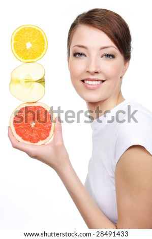 beauty portrait of young laughing woman with citrous fruits