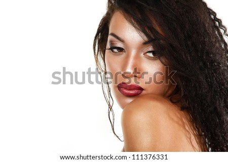 Beauty portrait of young mulatto fresh woman with beautiful makeup in profile over white background - stock photo